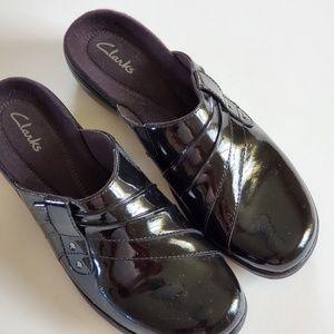 Clarks black mules size 7½